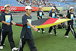 09 August 2008: Olympic volunteers carry the flag of Germany onto the field, pregame.  The women's Olympic soccer team of Germany defeated the women's Olympic soccer team of Nigeria 1-0 at Shenyang Olympic Sports Center Wulihe Stadium in Shenyang, China in a Group F round-robin match in the Women's Olympic Football competition.