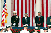 Washington, D.C. - May 29, 2006 -- United States President George W. Bush, right, bows his head in prayer prior to  making remarks at the annual Arlington National Cemetery Memorial Day Commemoration at Arlington National Cemetery in Arlington, Virginia  on May 29, 2006.  Frol eft to right: General Peter Pace, Chairman of the Joint Chiefs of Staff; United States Secretary of Defense Donald Rumsfeld; and President Bush.<br /> Credit: Ron Sachs  - Pool via CNP