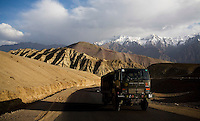 An Indian Army truck drives through stunning high altitude scenery while from Leh, Ladakh to Srinagar, Kashmir in the state of Jammu & Kashmir, India on 7th June 2009.  Photo by Suzanne Lee