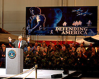Feb. 20, 2002, Nellis, Nevada, United States<br /> <br /> Secretary of Defense Donald H. Rumsfeld acknowledges the applause of the audience at Nellis Air Force Base, Nev., as he begins a town hall meeting on Feb. 20, 2002.  Rumsfeld is visiting Nellis to meet the troops and the local commanders stationed there.  <br /> <br /> (Mandatory Credit: DoD photo by  Robert. Valenca, U.S. Air Force -