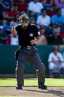 Home Plate Umpire Brian deBrauwere calls a strike during a game between the Corpus Christi Hooks and the Springfield Cardinals at Hammons Field on August 13, 2011 in Springfield, Missouri. Springfield defeated Corpus Christi 8-7. (David Welker / Four Seam Images)