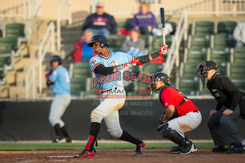Ti'Quan Forbes (10) of the Hickory Crawdads follows through on his swing against the Kannapolis Intimidators at Kannapolis Intimidators Stadium on April 10, 2016 in Kannapolis, North Carolina.  The Intimidators defeated the Crawdads 10-3.  (Brian Westerholt/Four Seam Images)