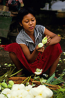Portrait of a female flower seller at a market, Bagan, Burma.