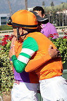 ARCADIA, CA  JUNE 2: Hall of Fame jockeys (and close friends) Gary Stevens and Mike Smith after the latter rides #6 Unique Bella to win the Beholder Mile (Grade l) on June 2, 2018 at Santa Anita Park in Arcadia, CA. (Photo by Casey Phillips/Eclipse Sportswire/Getty Images)