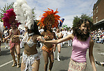 Danielle Euias, right, dances with Vamola carnival dancers in the 21st annual Summer Solstice Parade held Saturday, June 20, 2009 in Seattle, Wa. The parade was held Saturday, bringing out painted and naked bicyclists, bands, belly dancers and floats. (Jim Bryant Photo © 2009)... .