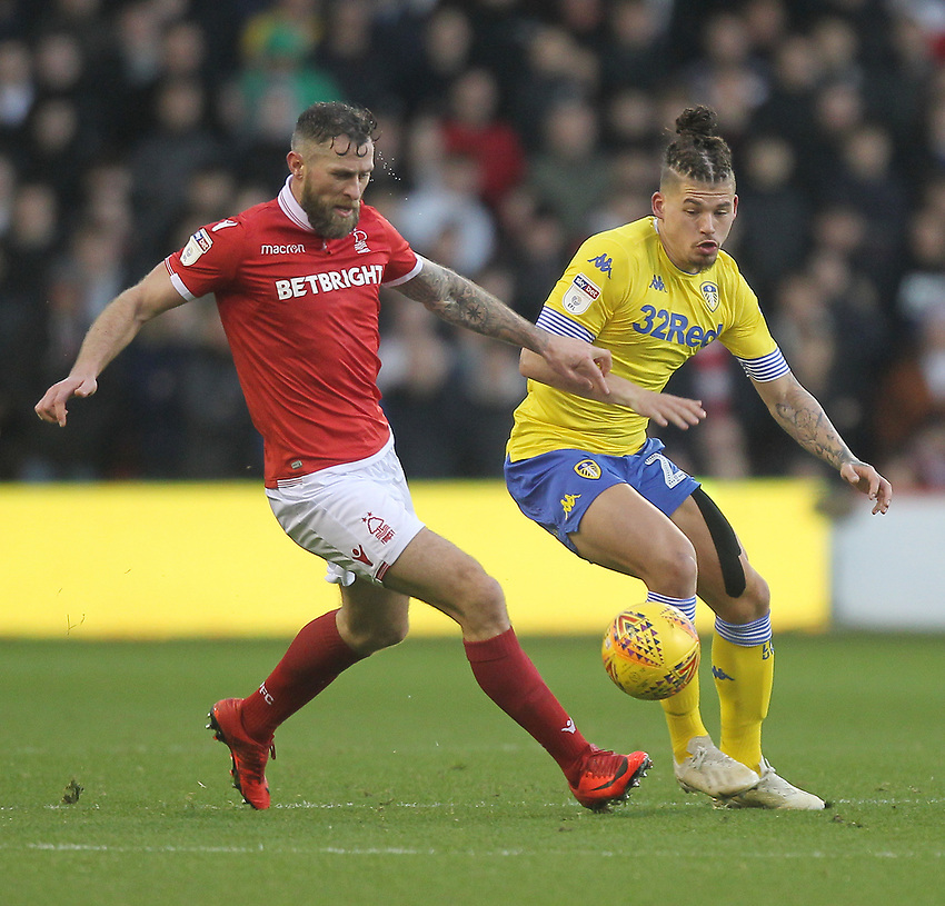 Leeds United's Kalvin Phillips in action with Nottingham Forest's Daryl Murphy<br /> <br /> Photographer Mick Walker/CameraSport<br /> <br /> The EFL Sky Bet Championship - Nottingham Forest v Leeds United - Tuesday 1st January 2019 - The City Ground - Nottingham<br /> <br /> World Copyright © 2019 CameraSport. All rights reserved. 43 Linden Ave. Countesthorpe. Leicester. England. LE8 5PG - Tel: +44 (0) 116 277 4147 - admin@camerasport.com - www.camerasport.com