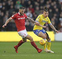 Leeds United's Kalvin Phillips in action with Nottingham Forest's Daryl Murphy<br /> <br /> Photographer Mick Walker/CameraSport<br /> <br /> The EFL Sky Bet Championship - Nottingham Forest v Leeds United - Tuesday 1st January 2019 - The City Ground - Nottingham<br /> <br /> World Copyright &copy; 2019 CameraSport. All rights reserved. 43 Linden Ave. Countesthorpe. Leicester. England. LE8 5PG - Tel: +44 (0) 116 277 4147 - admin@camerasport.com - www.camerasport.com