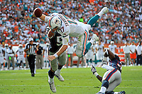 2 December 2012:  Miami quarterback Ryan Tannehill (17) is upended on his way to the end zone for a touchdown by New England cornerback Alfonzo Dennard (37) and defensive lineman Rob Ninkovich (50) in the second quarter as the New England Patriots defeated the Miami Dolphins, 23-16, at Sun Life Stadium in Miami Gardens, Florida.