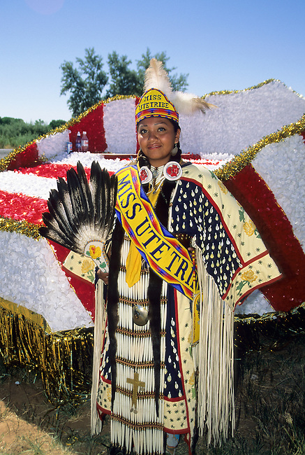 Teenage girl, with the title of Miss Ute Tribe, dressed in traditional regalia during a parade on the Uintah and Ouray reservation in Fort Duchesne, Utah with the title Miss Ute Tribe during a parade