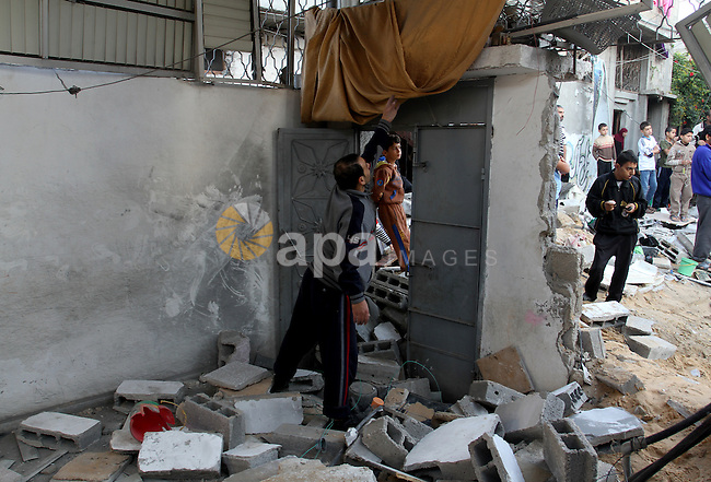 Palestinians inspect the damage after an Israeli air strike on a house in Gaza City on November 20, 2012. Israeli leaders discussed an Egyptian plan for a truce with Gaza's ruling Hamas, reports said, before a mission by the UN chief to Jerusalem and as the toll from Israeli raids on Gaza rose over 100. . Photo by Sameh Rohmi