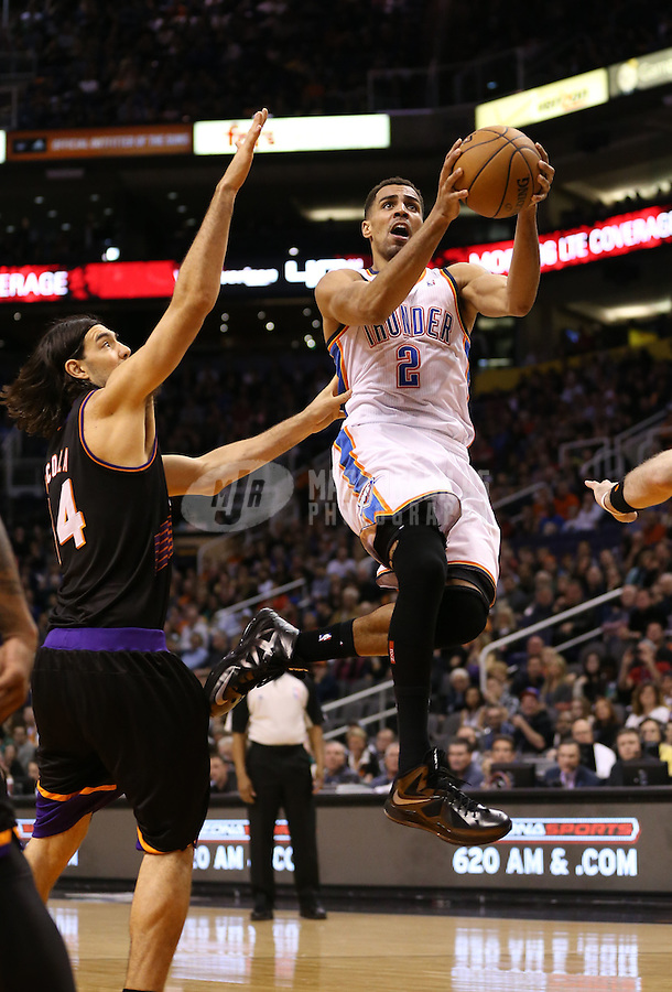 Feb. 10, 2013; Phoenix, AZ, USA: Oklahoma City Thunder shooting guard Thabo Sefolosha against the Phoenix Suns at the US Airways Center. Mandatory Credit: Mark J. Rebilas-