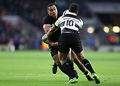 4th November 2017, Twickenham Stadium, Twickenham, England; Autumn International Rugby, Barbarians versus New Zealand; Nqani Laumape of New Zealand is tackled by Richie Mo'unga and Julian Saves of Barbarians
