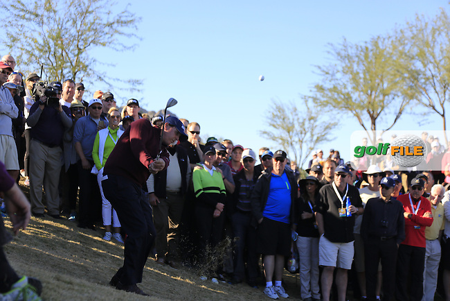 Phil Mickelson (USA) chips from the crowds at the 16th green during Saturday's Round 3 of the 2017 CareerBuilder Challenge held at PGA West, La Quinta, Palm Springs, California, USA.<br /> 21st January 2017.<br /> Picture: Eoin Clarke | Golffile<br /> <br /> <br /> All photos usage must carry mandatory copyright credit (&copy; Golffile | Eoin Clarke)