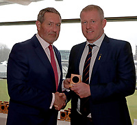 Graham Gooch (L) presents Anthony McGrath (R) with his County Championship winning medal during the Lord's Taverners Presentation at Lord's Cricket Ground on 12th March 2018