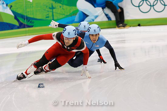 Trent Nelson  |  The Salt Lake Tribune.Men's 500m Semifinals, Short Track Speed Skating at the Pacific Coliseum Vancouver, XXI Olympic Winter Games, Friday, February 26, 2010. Francois-Louis Tremblay (canada), Apolo Anton Ohno (USA)
