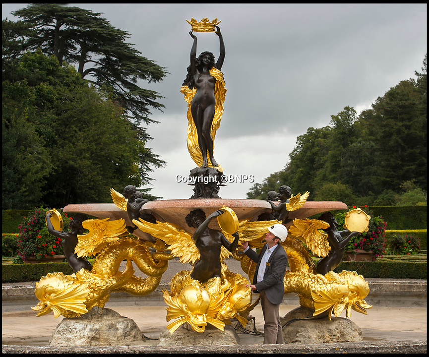 BNPS.co.uk (01202 558833)<br /> Pic: PhilYeomans/BNPS<br /> <br /> All that Glisters....Is Gold! <br /> <br /> This spectacular restoration of the Mermaid Fountain at Blenheim Palace uses 8750 leaves of real gold to restore its stunning golden hue.<br /> <br /> The ornate gilded bronze fountain has been returned to its original glory more than a century after its original installation.<br /> <br /> The Mermaid Fountain is the centrepiece of the formal Italian Garden at Blenheim Palace.<br /> <br /> Sculpted by renowned British/American artist Thomas Waldo Story it was installed at the Oxfordshire World Heritage Site by the 9th Duke of Marlborough in 1912.<br /> <br /> However over the decades the fountain became covered with a thick layer of limescale and algae and restorers used 350 books of almost pure 23 ¾ carat triple layer Old English gold to bring it back to life.<br /> <br /> The work is part of a £40 million rolling programme of conservation being carried out at the UNESCO World Heritage Site which was the birthplace of Winston Churchill.
