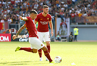 Roma's Aleksandar Kolarov, left, kicks a free kick past his teammate Jordan Veretout during the Serie A soccer match between Roma and Cagliari at Rome's Olympic Stadium, October 6, 2019. UPDATE IMAGES PRESS/ Riccardo De Luca