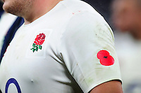 A general view of a Poppy on the sleeve of an England jersey for Remembrance weekend. Old Mutual Wealth Series International match between England and South Africa on November 12, 2016 at Twickenham Stadium in London, England. Photo by: Patrick Khachfe / Onside Images