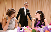 United States President Barack Obama is flanked by first lady Michelle Obama and Saturday Night Live's comedian Cecily Strong during the annual White House Correspondent's Association Gala at the Washington Hilton hotel April 25, 2015 in Washington, D.C. The dinner is an annual event attended by journalists, politicians and celebrities.<br /> Credit: Olivier Douliery / Pool via CNP