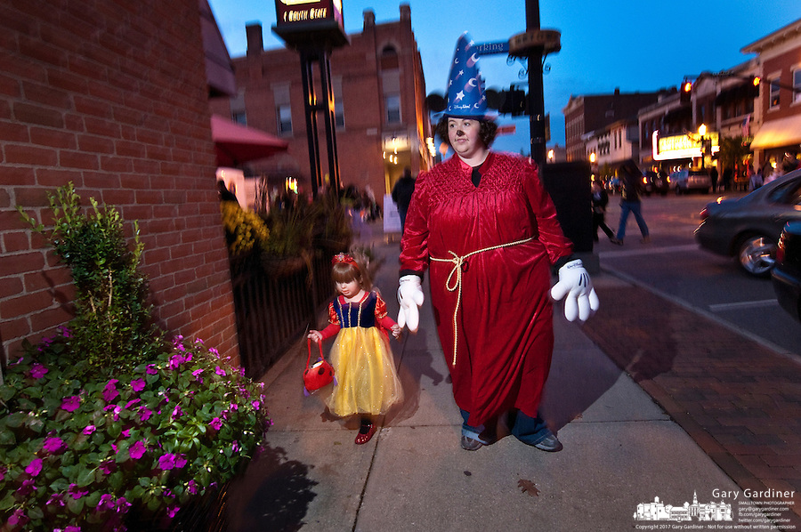 Mother and daughter dressed as Mickey Mouse in The Sorcerer's Apprentice and Snow White  for Midnight Madness in Uptown Westerville the Friday before Halloween.