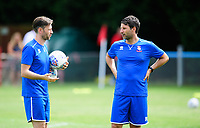 Lincoln City's assistant manager Nicky Cowley, left, and Lincoln City manager Danny Cowley during the pre-match warm-up <br /> <br /> Photographer Chris Vaughan/CameraSport<br /> <br /> Football - Pre-Season Friendly - Lincoln United v Lincoln City - Saturday 8th July 2017 - Sun Hat Villas Stadium - Lincoln<br /> <br /> World Copyright &copy; 2017 CameraSport. All rights reserved. 43 Linden Ave. Countesthorpe. Leicester. England. LE8 5PG - Tel: +44 (0) 116 277 4147 - admin@camerasport.com - www.camerasport.com