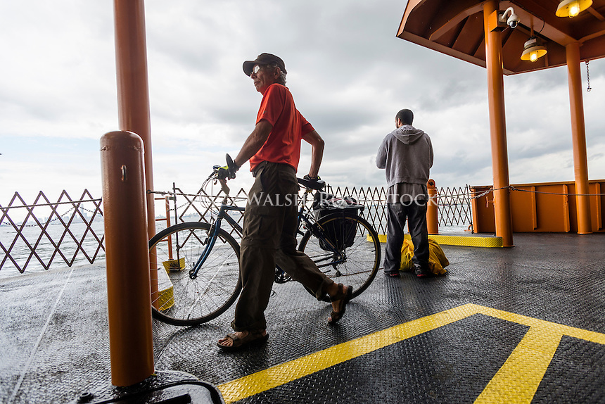 Staten Island, NY - 23 Aug 2014 - Bicycle commuter on the Staten Island Ferry