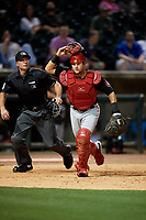 Chattanooga Lookouts catcher Chris Okey (19) and umpire Matthew Brown get in position during a Southern League game against the Birmingham Barons on May 1, 2019 at Regions Field in Birmingham, Alabama.  Chattanooga defeated Birmingham 5-0.  (Mike Janes/Four Seam Images)
