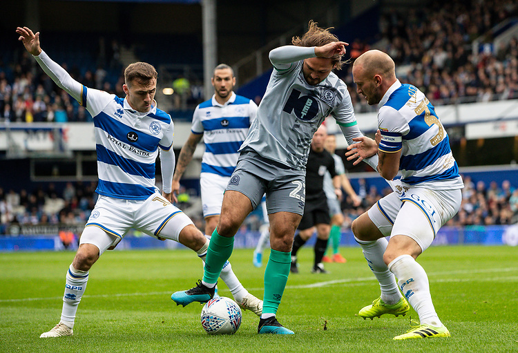 Blackburn Rovers' Bradley Dack (centre) competing with Queens Park Rangers' Josh Scowen (left) and Toni Leistner <br /> <br /> Photographer Andrew Kearns/CameraSport<br /> <br /> The EFL Sky Bet Championship - Queens Park Rangers v Blackburn Rovers - Saturday 5th October 2019 - Loftus Road - London<br /> <br /> World Copyright © 2019 CameraSport. All rights reserved. 43 Linden Ave. Countesthorpe. Leicester. England. LE8 5PG - Tel: +44 (0) 116 277 4147 - admin@camerasport.com - www.camerasport.com