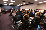 An overflow crowd watches a hearing at the Legislative Building in Carson City, Nev., on Monday, Feb. 23, 2015. <br /> Photo by Cathleen Allison