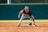 Shortstop Champ Rowland (4) of the College of Charleston Cougars awaits the throw from home in a game against the University of South Carolina Upstate Spartans on Tuesday, March 31, 2015, at Cleveland S. Harley Park in Spartanburg, South Carolina. Charleston won, 10-0. (Tom Priddy/Four Seam Images)