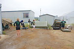 Earthwatch Team Putting Things Away After Being In The Field