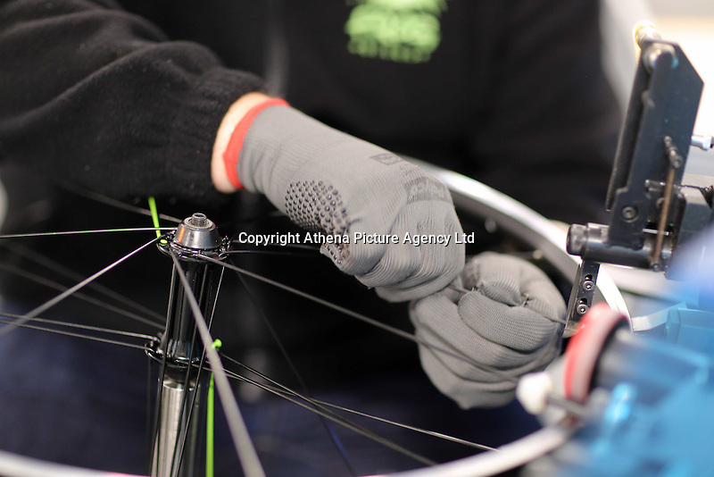 Pictured: Spokes and rims get assembled Monday 15 August 2016<br />