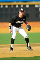 Wake Forest Demon Deacons third baseman Joe Napolitano (12) on defense against the North Carolina State Wolfpack at Wake Forest Baseball Park on March 16, 2013 in Winston-Salem, North Carolina.  The Demon Deacons defeated the Wolfpack 13-4.  (Brian Westerholt/Four Seam Images)