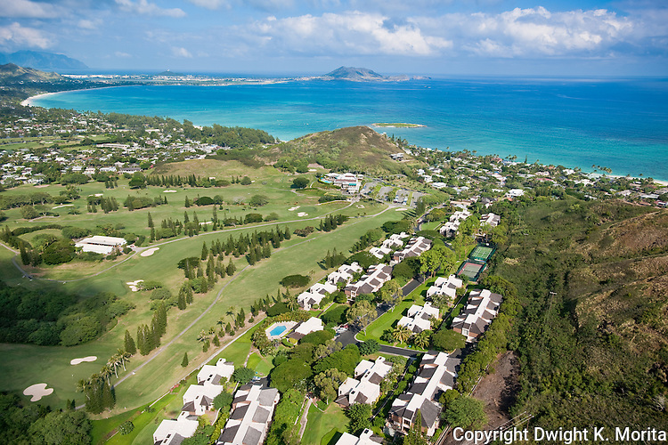 Bluestone Condominiums - Kaelepulu street condos front the 18th fairway leading to the clubhouse at the Mid-Pacific Country Club. Bluestone Community Center and pool visible in the foreground and the tennis courts in the middle right.