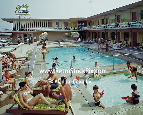Kids playing with toys in the Golden Nugget Motel's kiddie pool. Wildwood, NJ. 1960's.