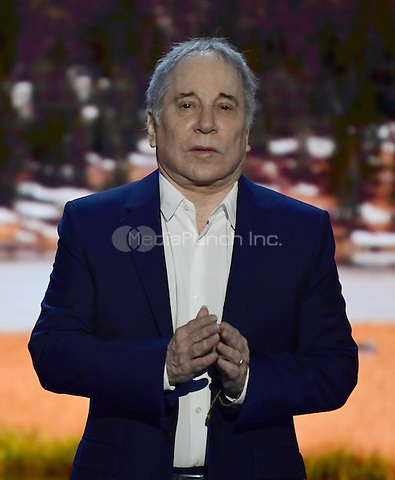Singer and songwriter Paul Simon performs &quot;Bridge over Troubled Water&quot; at the 2016 Democratic National Convention at the Wells Fargo Center in Philadelphia, Pennsylvania on Monday, July 25, 2016.<br /> Credit: Ron Sachs / CNP/MediaPunch<br /> (RESTRICTION: NO New York or New Jersey Newspapers or newspapers within a 75 mile radius of New York City)
