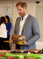 14 May 2019 - Prince Harry Duke of Sussex, holds a loaf of bread as he visits a food bank during a visit to Barton Neighbourhood Centre in Oxford. The centre is a hub for local residents which houses a doctor's surgery, food bank, cafe and youth club. Photo Credit: ALPR/AdMedia