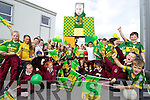 Children at Moyderwell school with a fifteen foot statue of Kerry footballer Kieran Donaghy.