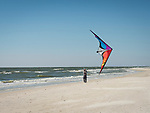 Flying kite on the beach in Cape San Blas, FL in march.