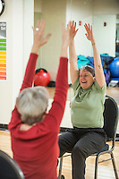 STAFF PHOTO ANTHONY REYES &bull; @NWATONYR<br /> Fink Holloway leads her class in the Strong Bodies program Tuesday, Dec. 23, 2014 at the Jones Center in Springdale. The program promotes fitness for seniors. The Jones Center will soon start a Silver Sneakers program, where seniors can qualify through their insurance for a free fitness membership.