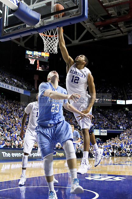 Kentucky forward Karl-Anthony Towns blocks a ball during the second half of the UK men's basketball game vs. Columbia at Rupp Arena in Lexington , Ky., on Wednesday, December 10, 2014. Photo by Jonathan Krueger | Staff