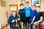 l-r  Jack Greeney, Timmy Cleary, Darragh Quirke, Paudie Fitzgerald Castlegregory U13's GAA who are playing in Clahane for the Patrick Rohan Memorial Cup with  92 year-old Eddie Boyle, holding the Patrick Rohan Memorial Cup,  the last living player from the 1943 final, last time the final was played in Clahane over 70 years ago