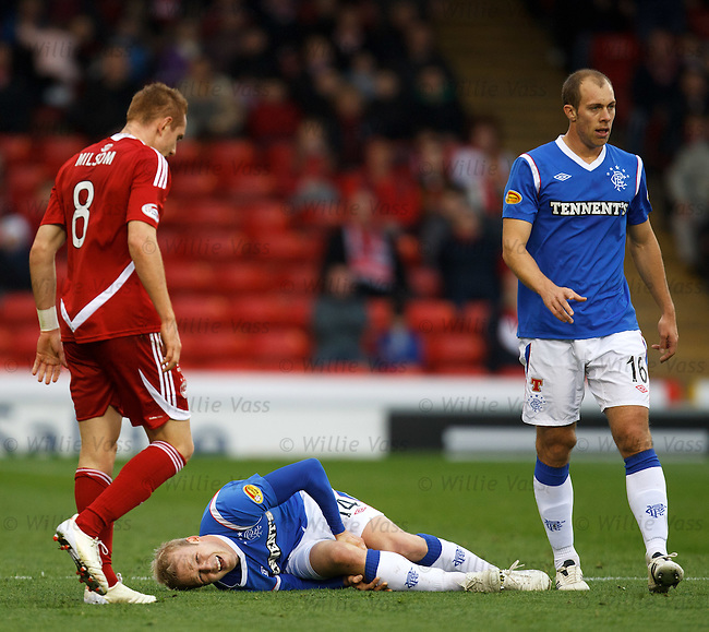 The first of two injuries to Steven Naismith's knee as he lies crumpled in agony after going in on Rob Milsom at Pittodrie.  Incredibly he was sent back on after treatment only to do the same knee a second and final time again during the match.