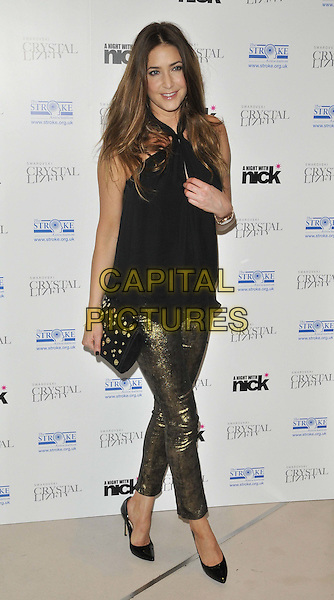 "Lisa Snowdon.The ""A Night With Nick"" charity event in aid of The Stroke Association, Swarovski CRYSTALLIZED, Gt. Marlborough St., London, England..December 6th, 2011.full length black top gold bronze trousers clutch bag studs studded  .CAP/CAN.©Can Nguyen/Capital Pictures."