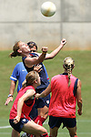 28 July 2006: Lori Chalupny (arms extended) rises to win a ball in training as head coach Greg Ryan (behind) looks on. The United States Women's National Team trained at SAS Soccer Park in Cary, North Carolina, in preparation for an International Friendly match against Canada to be played on Sunday, July 30.