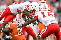 January 1, 2009:     Nebraska safety Adam Watson (24) dives for yardage during first half game action in the 64th annual Konica Minolta Gator Bowl between the Nebraska Cornhuskers  and the Clemson Tigers  at Jacksonville Municipal Stadium in Jacksonville, Florida.