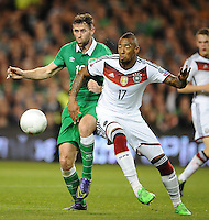 08/10/2015; UEFA Euro 2016 Group D Qualifier - Republic of Ireland v Germany, Aviva Stadium, Dublin. <br /> Ireland&rsquo;s Robbie Brady with Jerome Boateng of Germany.<br /> Picture credit: Tommy Grealy/actionshots.ie.
