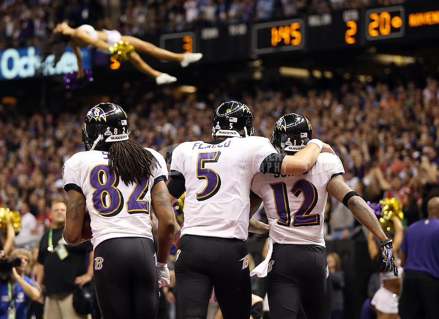 Feb 3, 2013; New Orleans, LA, USA; Baltimore Ravens wide receiver Jacoby Jones (12) celebrates with wide receiver Torrey Smith (82) and quarterback Joe Flacco (5) after scoring a touchdown against the San Francisco 49ers in the second quarter in Super Bowl XLVII at the Mercedes-Benz Superdome. Mandatory Credit: Mark J. Rebilas-