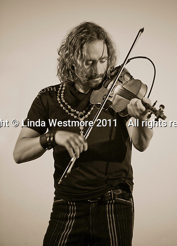 Richard Wood, Canadian electric fiddle player.  Playing at a gig to raise funds for the local swimming pool, Northchapel, Sussex,
