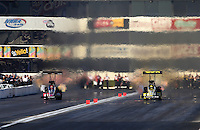 Feb. 16, 2013; Pomona, CA, USA; NHRA top fuel dragster driver Morgan Lucas (right) races alongside David Grubnic during qualifying for the Winternationals at Auto Club Raceway at Pomona.. Mandatory Credit: Mark J. Rebilas-